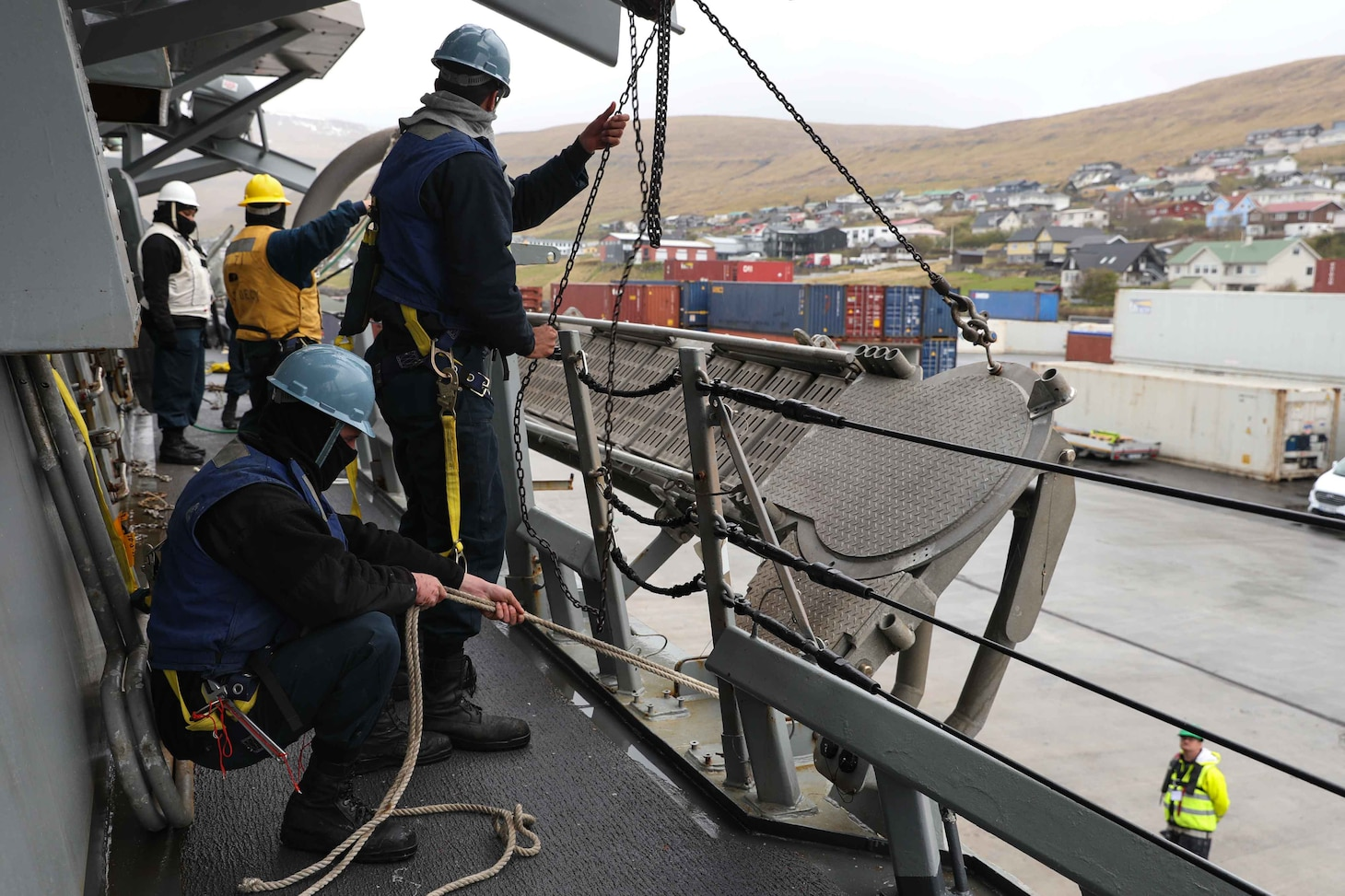 Sailors stationed aboard the Arleigh Burke-class guided-missile destroyer USS Ross (DDG 71) lower an accomodation ladder to the pier in port in the Faroe Islands, May 15, 2021.