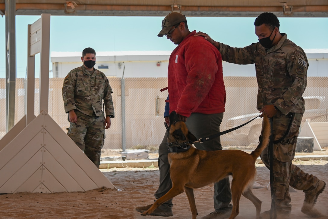 A photo of a ceremony and K-9 demonstration