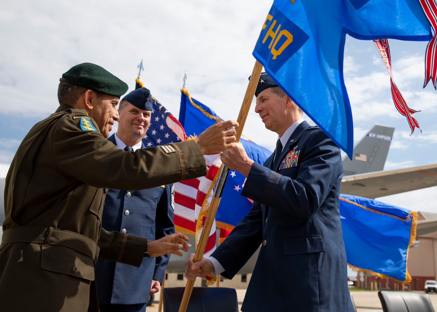 NH Adjutant Gen. David Mikolaities passes the organizational flag to incoming commander of the NH Air National Guard, Brig. Gen. Jed French, at a change of command ceremony May 15 at Pease Air National Guard Base.