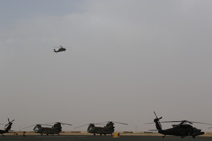 A UH-60 Black Hawk helicopter, operated by Soldiers with the 28th Expeditionary Combat Aviation Brigade, flies over an airfield in the 28th ECAB's area of operations in the Middle East.