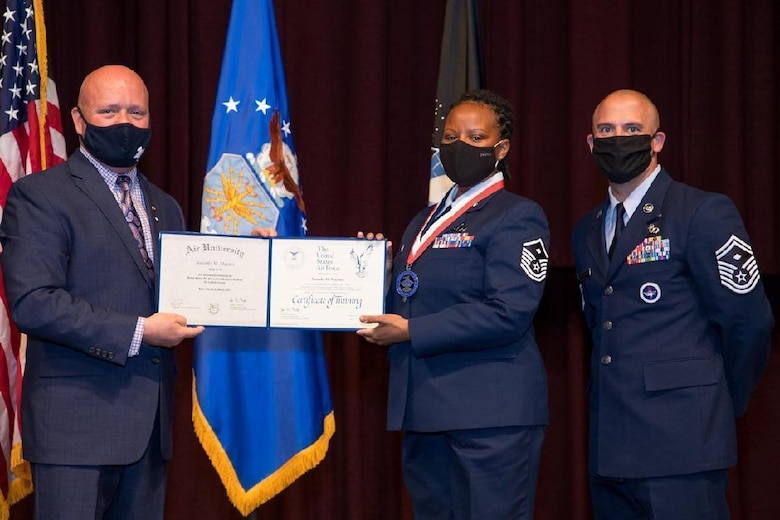 Award presentation in dress blues.