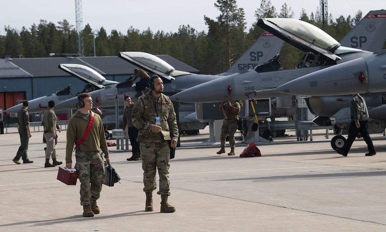 U.S. Air Force F-16 Fighting Falcon aircraft and Airmen assigned to the 52nd Fighter Wing at Spangdahlem Air Base, Germany, arrive at Kallax Air Base, Sweden, May 17, 2021. The aircraft will support the Arctic Challenge Exercise 21, during which the U.S., allies and partner nations will exercise the ability to plan, execute and evaluate Large Force Employments in a multinational air operation. (U.S. Air Force photo by Senior Airman Ali Stewart)