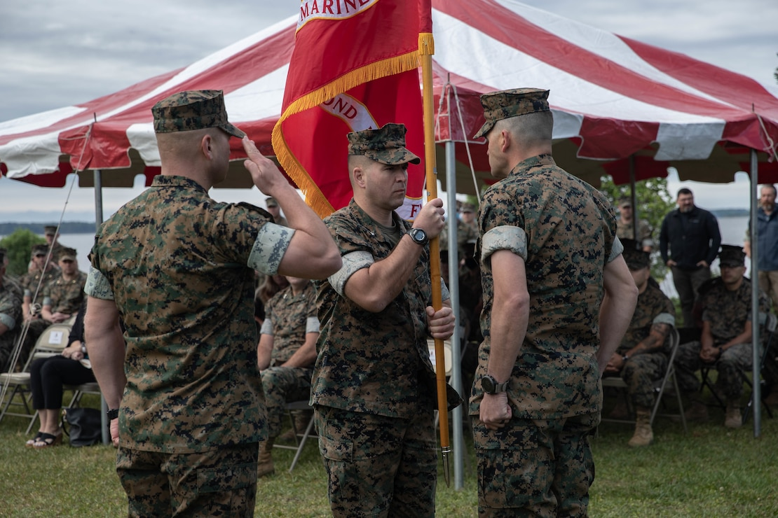 U.S. Marine Corps Lt. Col. Gabriel Diana, a native of Columbus, Ohio and the outgoing commander of 1st Battalion, 2d Marine Regiment (V12), 2d Marine Division, passes the colors to Lt. Col. Aaron Awtry, a native of Midland, Texas and the incoming commander, during a change of command ceremony on Camp Lejeune, N.C., May 13, 2021. The passing of colors is a tradition symbolizing the transfer of authority, responsibility and accountability of the Marine and Sailors under the commander's charge. (U.S. Marine Corps photo by Lance Cpl. Jennifer E. Reyes)