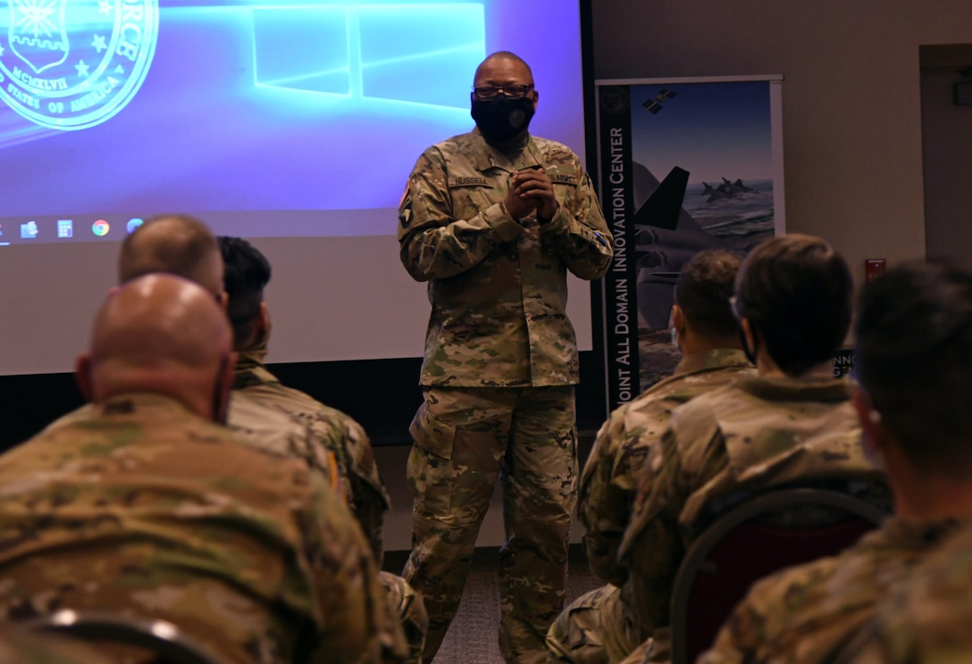 U.S. Army Command Sgt. Maj. William W. Russell III, state command sergeant major and senior enlisted leader of the Michigan National Guard addresses a group during a joint enlisted and company grade officer professional development training