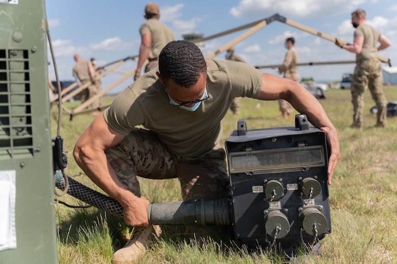 Airman connecting a generator.