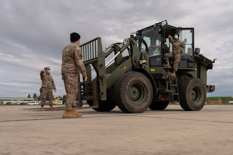 Airmen operating a forklift.