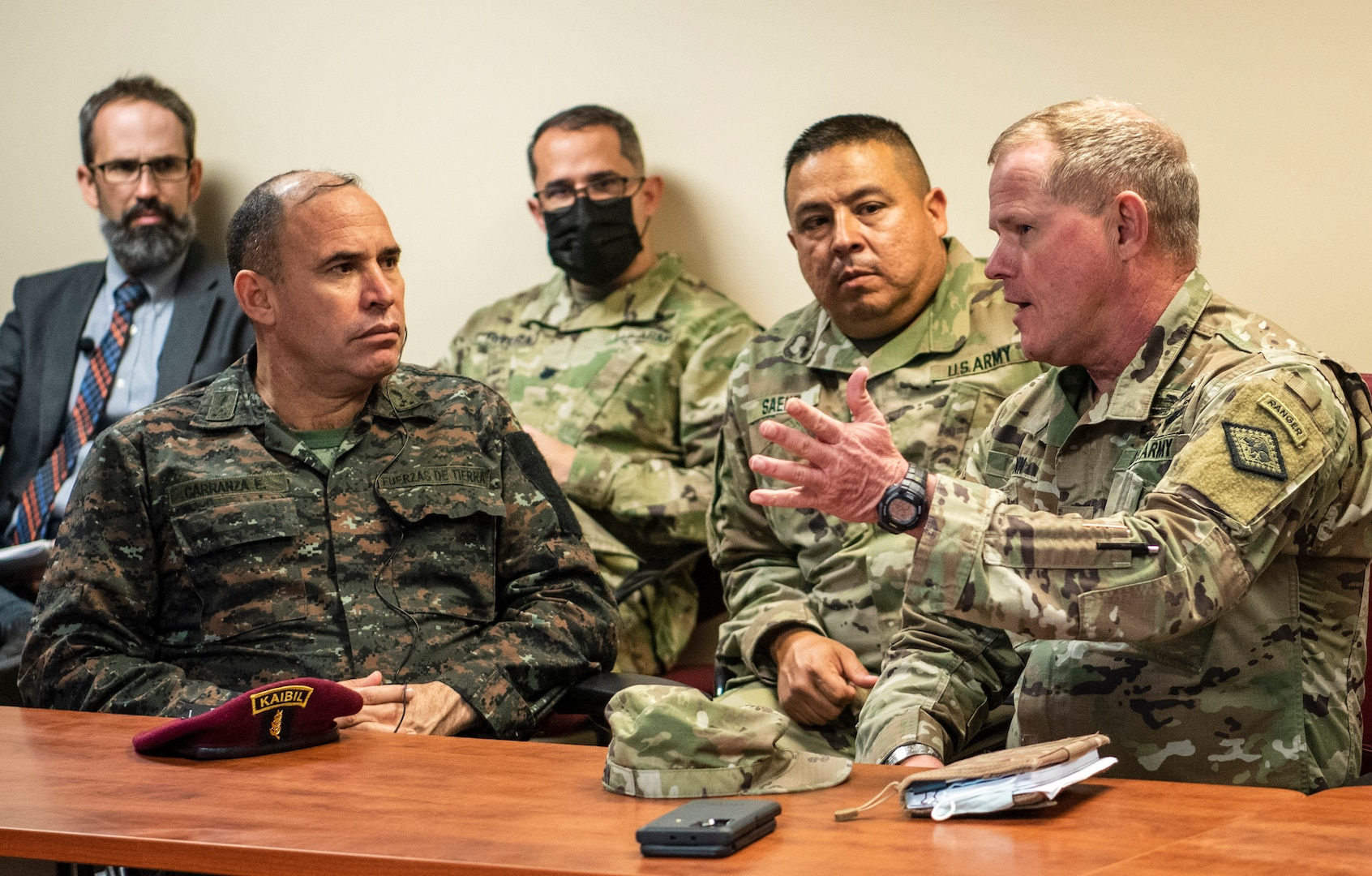 Maj. Gen. Kendall Penn, right, the Arkansas National Guard adjutant general, speaks with Maj. Gen Walfre Omar Carranza España, the Guatemalan chief of defense, during a May 13, 2021, briefing in North Little Rock about the Arkansas National Guard's role in statewide emergencies. Arkansas and Guatemala, paired together since 2002 in the National Guard Bureau's State Partnership Program, have a rich history of military and cultural exchanges.
