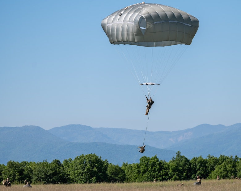A paratrooper approaching the ground.