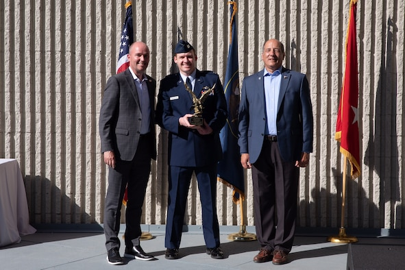 Capt. Mark Tappendorf, reservist in the 419th Fighter Wing, accepts Utah's Company Grade Officer of the Year award from Gov Spencer Cox and Gary Harter, executive director of Utah's Department of Veteran and Military Affairs during a ceremony May 15 in Murray, Utah.