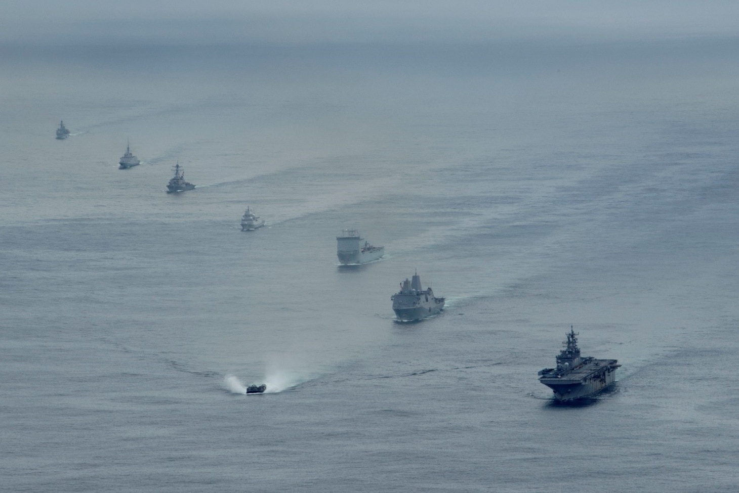 Ships from the U.S. Navy's Iwo Jima Amphibious Ready Group (IWOARG), the Royal Navy's Queen Elizabeth Carrier Strike Group and the French and Norwegian navies transit the Atlantic Ocean in formation during a photo exercise, May 17, 2021.