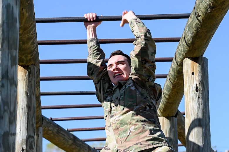 Airman 1st Class Justin Dunlevy, 75th Security Forces Squadron, runs through the monkey bars in the National Police Week obstacle course competition May 11, 2021, at Hill Air Force Base, Utah. The obstacle course competition was one of many events 75th SFS hosted to commemorate the week to honor the sacrifices of the law enforcement community. (U.S. Air Force photo by Cynthia Griggs)