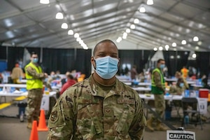 U.S. Air Force Staff Sgt. Deshaun Jones, an Airman assigned to the 6th Force Support Squadron based in Tampa, Florida, poses for a photo at the Community Vaccination Center (CVC) at the Minnesota State Fairgrounds in St. Paul, Minnesota, April 26, 2021. The CVC is completely operational and is welcoming the St. Paul community to receive free COVID-19 vaccines. U.S. Northern Command, through U.S. Army North, remains committed to providing continued, flexible Department of Defense support to the Federal Emergency Management Agency as part of the whole-of-government response to COVID-19. (U.S. Army photo by Spc. Hunter Garcia)