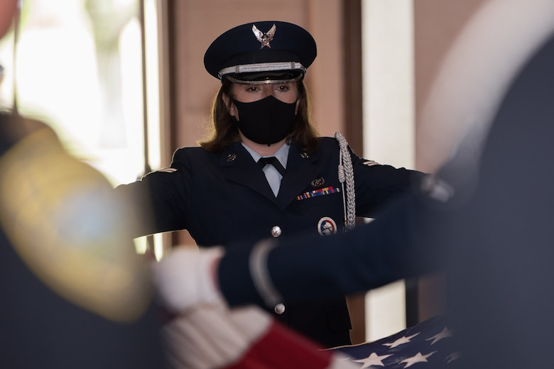 Airman 1st Class Christine Rogers, 22nd Force Support Squadron honor guardsman, folds a flag during a National Police Week Guard Mount ceremony May 14, 2021, at McConnell Air Force Base, Kansas. The Guard Mount ceremony was held to honor fallen law enforcement officers from McConnell and across the state of Kansas. (U.S. Air Force photo by Senior Airman Alexi Bosarge)