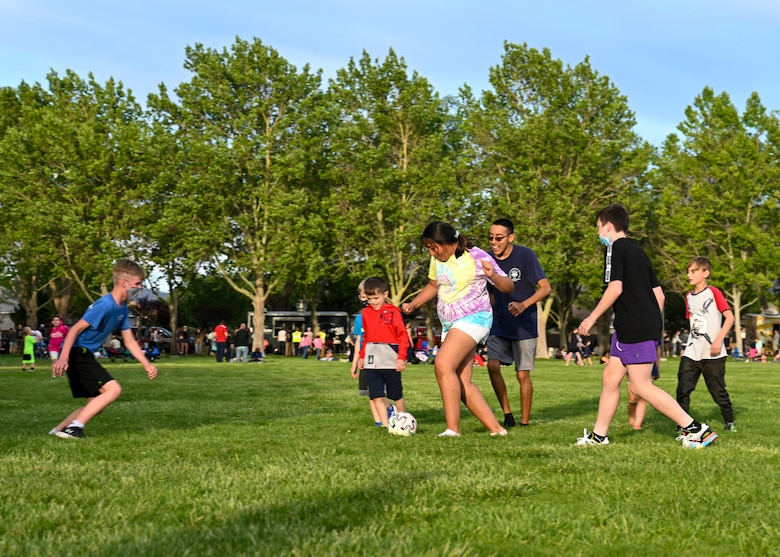 Children play at the balloon glow event