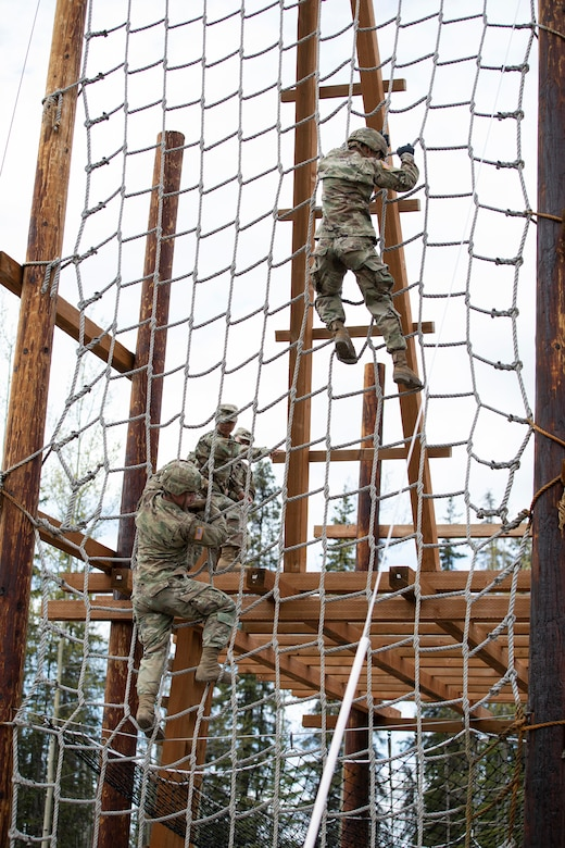 Alaska Army National Guardsmen descend on the obstacle course that is a part of the Alaska Army National Guard Best Warrior Competition May 15, 2021, at Joint Base Elmendorf-Richardson. The Best Warrior Competition recognizes Soldiers who demonstrate commitment to the Army values and embody the warrior ethos. (U.S. Army National Guard photo by Spc. Marc Marmeto).