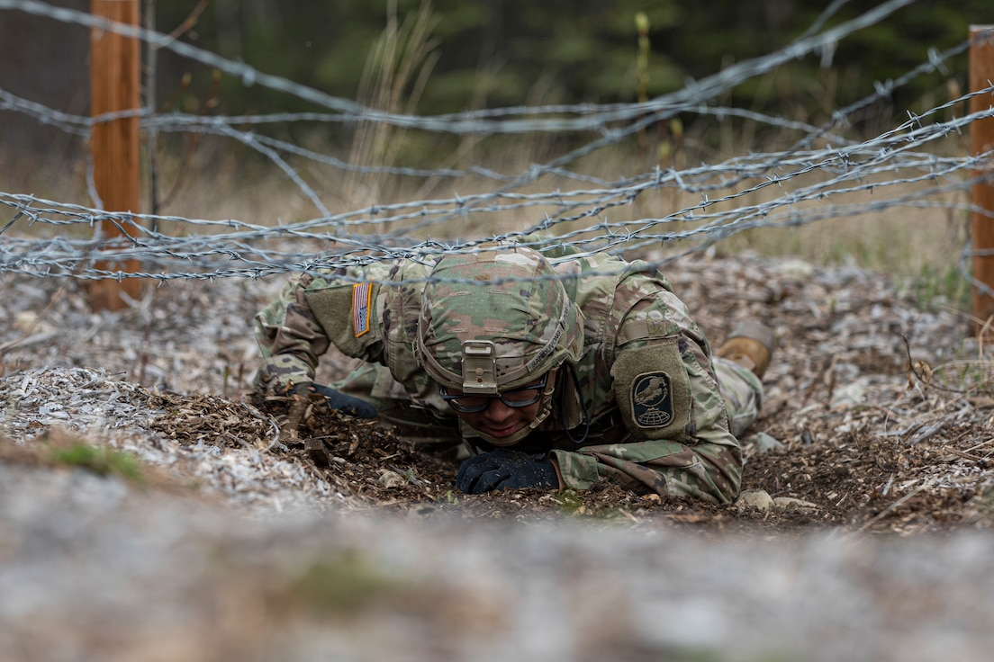 Alaska Army National Guardsman Spc. Jysamon Sanouvong, a military police officer assigned to the 49th Military Police Ground Based Interceptor Security Company, goes through the obstacle course portion of the Alaska Army National Guard Best Warrior Competition May, 15, 2021 at Joint Base Elmendorf-Richardson. The Best Warrior Competition recognizes Soldiers who demonstrate commitment to the Army values and embody the warrior ethos. (U.S. Army National Guard photo by Spc. Marc Marmeto).