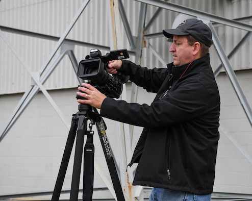 David Wright, a videographer for Arnold Engineering Development Complex, sets up his camera to capture video in support of the AEDC test mission, Dec. 14, 2020, at Arnold Air Force Base, Tenn. When not putting his video and editing skills to use at Arnold, Wright spends his free time on other creative projects, such as writing fantasy fiction novels. (U.S. Air Force photo by Jill Pickett)