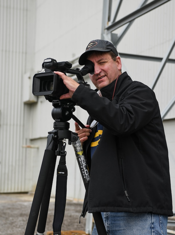 David Wright, a videographer for Arnold Engineering Development Complex, lines up a shot as he prepares to record video in support of the AEDC test mission, Dec. 14, 2020, at Arnold Air Force Base, Tenn. When not putting his video and editing skills to use at Arnold, Wright spends his free time on other creative projects, such as writing fantasy fiction novels. (U.S. Air Force photo by Jill Pickett)