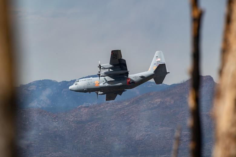 C-130 dropping potable water on mountain ridge