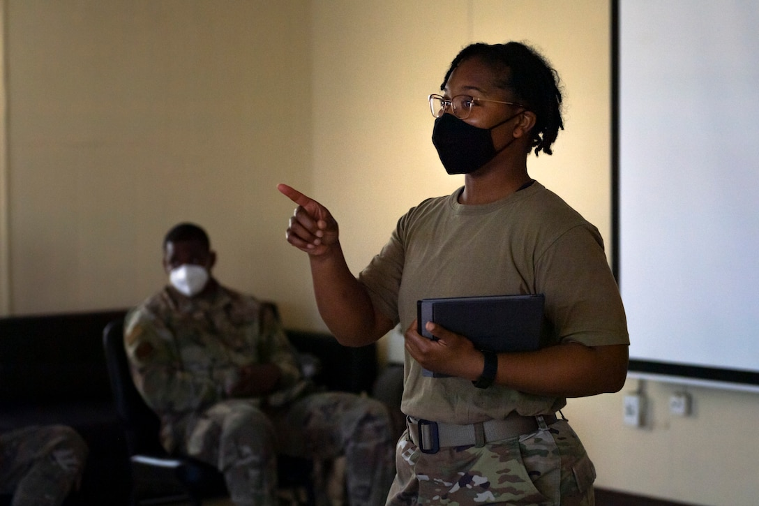 A photo of an Airman speaking to a group