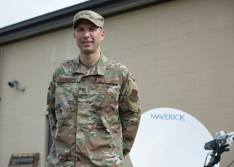Air Force Master Sgt. Seth Garceau, a member of the 103rd Communications Squadron, stands in front of a satellite dish that he set up, Sept. 30, 2020 at Bradley Air National Guard Base, Conn. The set up was part of an expansive communications project. (U.S. Air National Guard photo by Tech. Sgt. Tamara R. Dabney)