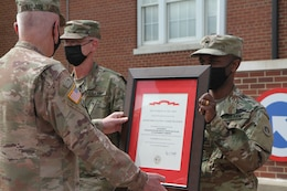 soldier receives MUC from commanding general