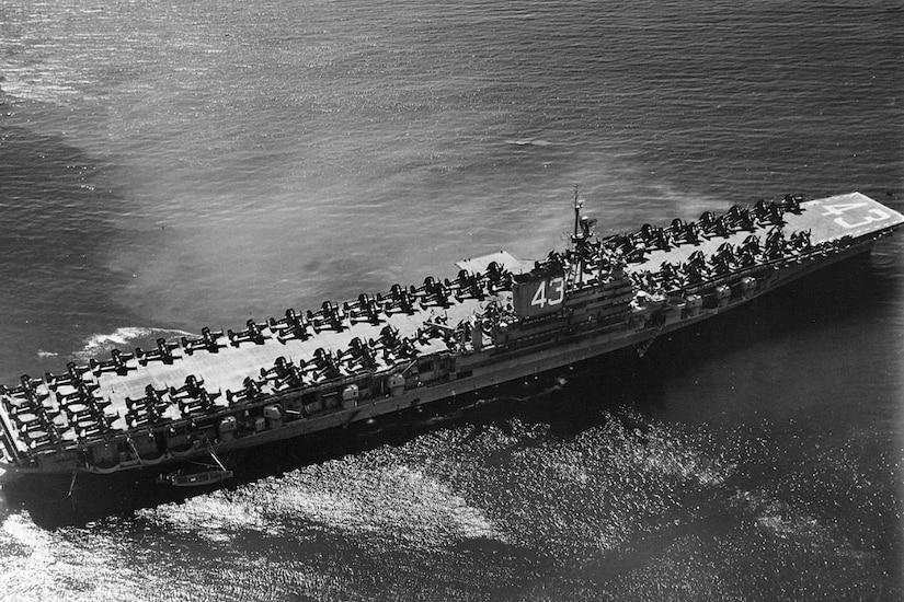 Aircraft carrier sails sea.