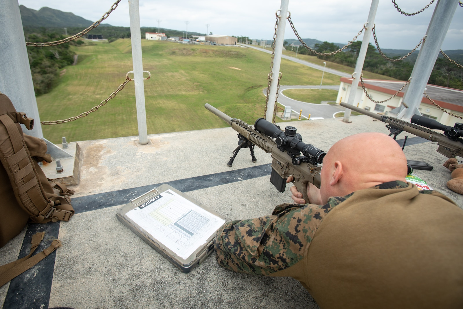 Cpl Miller sights in from the top of the Sniper Tower