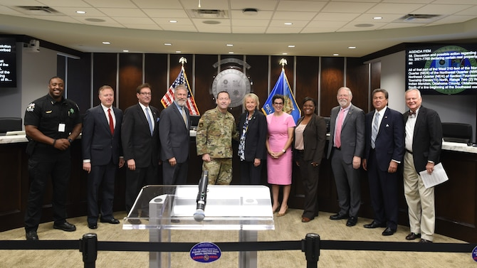 Members of Tinker AFB and Oklahoma County Commissioners Board posing for group photo.