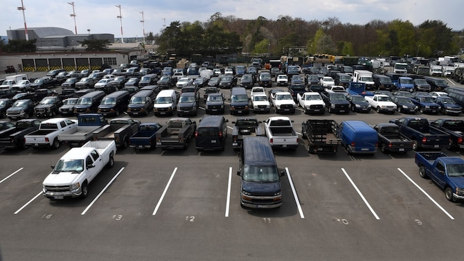 Vehicles sit in a compound at Ramstein Air Base, Germany
