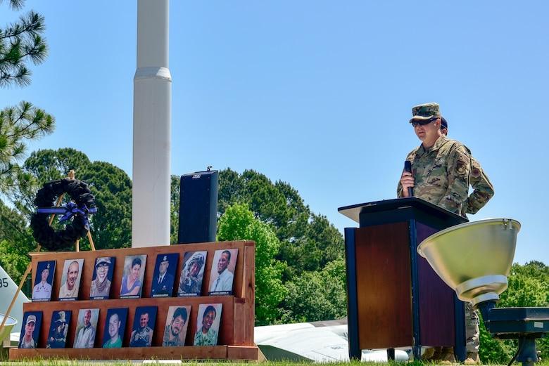 Airmen fold the American flag