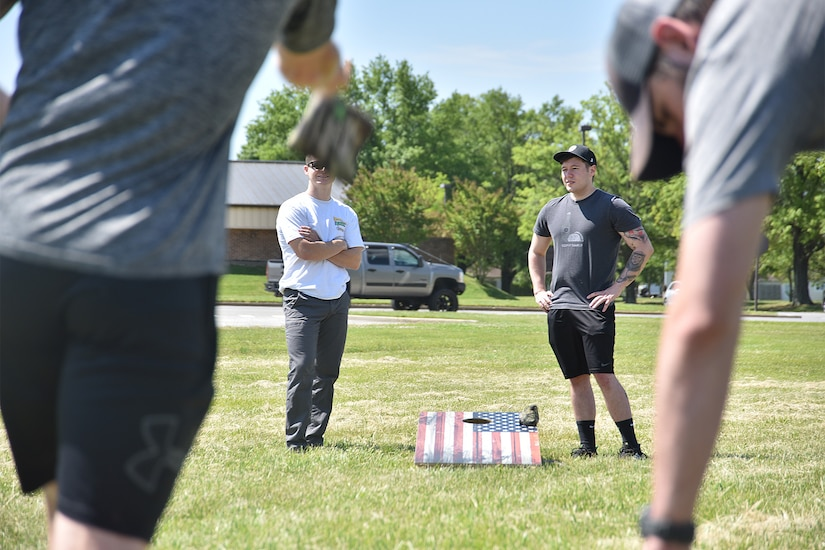 Airmen participate in a cornhole tournament during National Police Week, May 14, 2021, at Joint Base Andrews, Md. National Police Week was established by Congress in 1962 to honor members of law enforcement who lost their lives in the line of duty. JBA celebrated National Police Week with a 5k run and ruck march, security forces demonstrations, bowling, a cornhole tournament, softball games and a barbecue. (U.S. Air Force photo by Senior Airman Daniel Brosam)