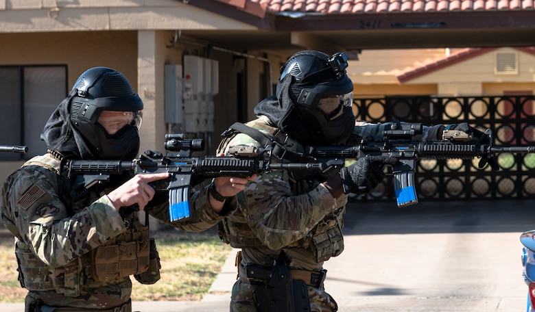 Tech. Sgt. John Cruikshank, 56th Security Forces flight sergeant (left), and Tech. Sgt. Evan Adonteng, 56th SFS noncommissioned officer in charge of operations, participate in a barricaded suspect demo May 14, 2021, at Luke Air Force Base, Arizona.