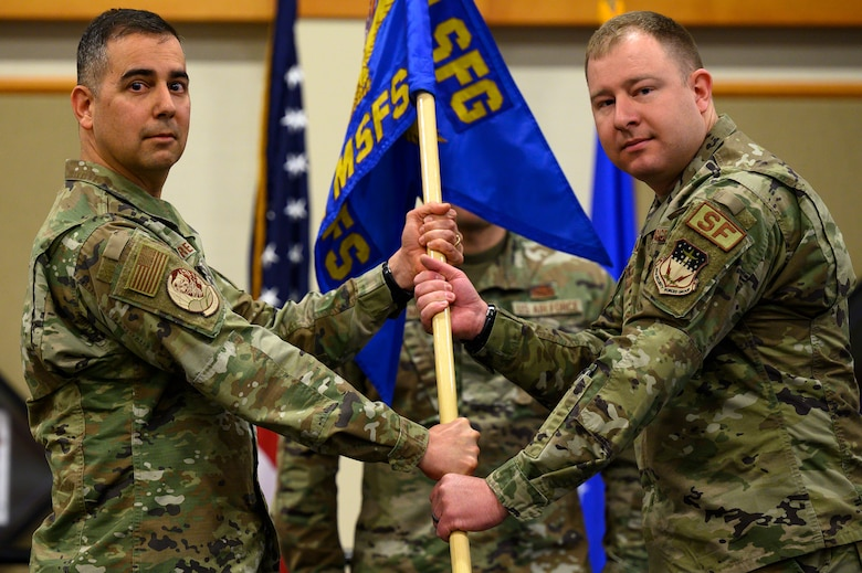 Maj. Richard Glover, right, accepts command of the 341st Missile Security Forces Squadron from Col. Frank Reyes, 341st Security Forces Group commander, during a change of command ceremony May 18, 2021, at Malmstrom Air Force Base, Mont.