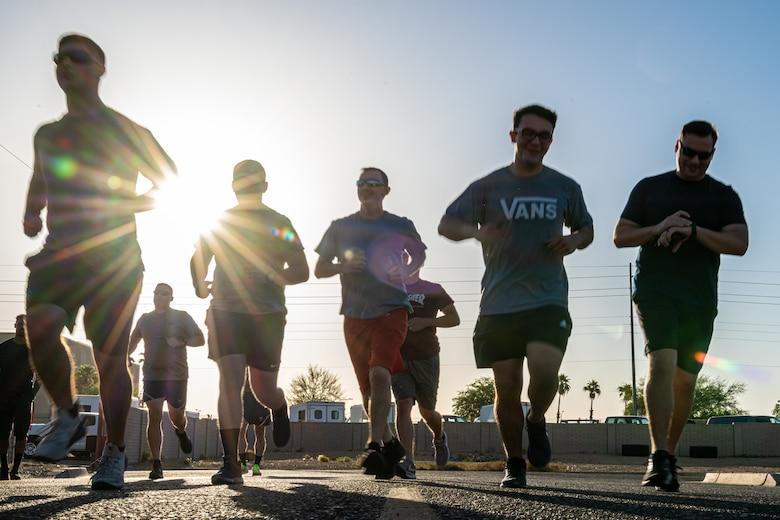 Members of the 56th Fighter Wing run in the Police Week five-kilometer run, May 13, 2021, at Luke Air Force Base, Arizona.