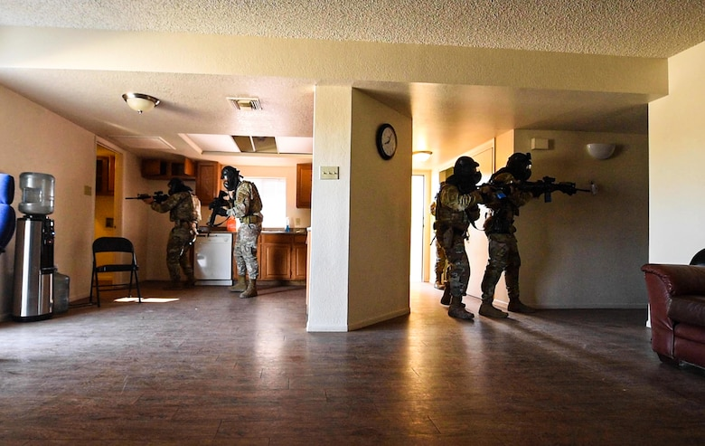 Airmen from the 56th Security Forces Squadron clear a house during a barricaded suspect demo, May 14, 2021, at Luke Air Force Base, Arizona.