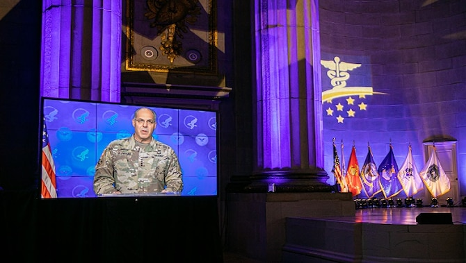Image of a soldier talking on a television screen.