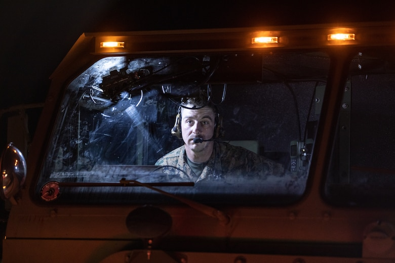 U.S. Marine Corps Cpl. Joseph Pursley, a motor vehicle operator, conducts a radio check from inside a logistics vehicle system replacement on Kirkland Air Force Base, New Mexico, May 13, 2021. Marines with 2nd Transportation Battalion, Combat Logistics Regiment 2, 2nd Marine Logistics Group conducted a convoy across the United States starting in Camp Lejeune, North Carolina and arriving at Marine Corps Air Ground Combat Center Twentynine Palms, California, in one of the longest convoys in recent Marine Corps history. (U.S. Marine Corps photo by Lance Cpl. Scott Jenkins)