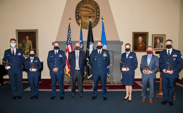 The Honorable John Roth, acting secretary of the Air Force, center left, and Lt. Gen. James Hecker, Air University commander and president, center right, stand with recipients of the 2021 Secretary of the Air Force Leadership Awards, May 11, 2021, at Maxwell Air Force Base, Alabama. The award is presented annually to Air University faculty, staff and students who have displayed exemplary leadership, character and ethical behavior that distinguished them from their peers. Award recipients pictured are (left-right): Master Sgt. Charles Simper, Cadet Wing Commander Kierenne Eadie, U.S. Space Force Maj. Kyle Keith, Maj. Tamara Merritt, Jason Womack and Tech. Sgt. Daniel Keeling. Master Sgt. Jaime Matekaitis was not available to receive the award in person. (U.S. Air Force photo by William Birchfield)