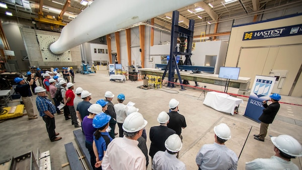 Shown is University of Maine's full-scale structural testing of a composite material bridge girder system used for rapid construction of lightweight bridge structures.