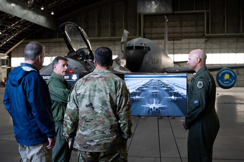 U.S. Navy Adm. John Aquilino, second from left, the U.S. Indo-Pacific Command (USINDOPACOM) commander, interacts with, Sen. Dan Sullivan, left, Command Sgt. Maj. Shane W. Shorter, second from right, the USINDOPACOM command senior enlisted leader, and Air Force Col. David Berkland, the 354th Fighter Wing commander, on Eielson Air Force Base, Alaska, May 15, 2021.