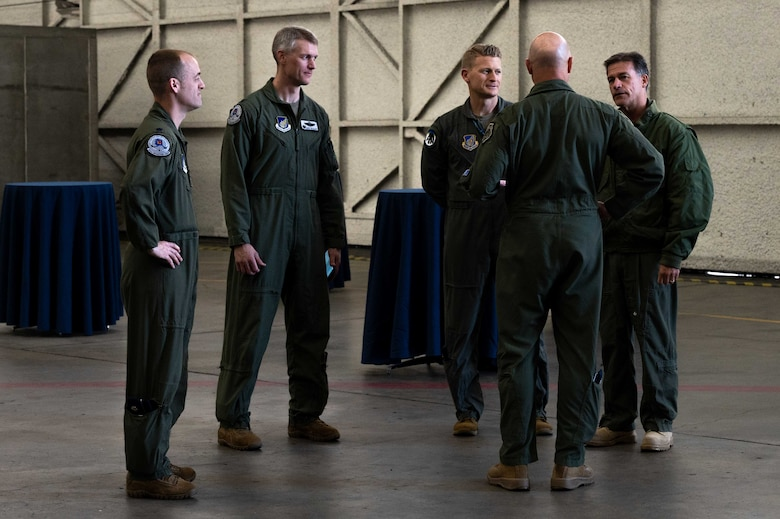 U.S. Navy Adm. John Aquilino, right, the U.S. Indo-Pacific Command (USINDOPACOM) commander, speaks with the leadership from the 354th Fighter Wing, on Eielson Air Force Base, Alaska, May 15, 2021.