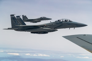 F-15EX Eagle II's from the 40th Flight Test Squadron, 96th Test Wing, and the 85th Test and Evaluation Squadron, 53rd Wing, both out of Eglin Air Force Base, Florida, fly in formation during aerial refueling operations with a KC-135 Stratotanker from the 370th Flight Test Squadron out of Edwards Air Force Base, California, May 14. The Eagle II participated in the Northern Edge 21 exercise in Alaska earlier in May. (Air Force photo by Ethan Wagner)