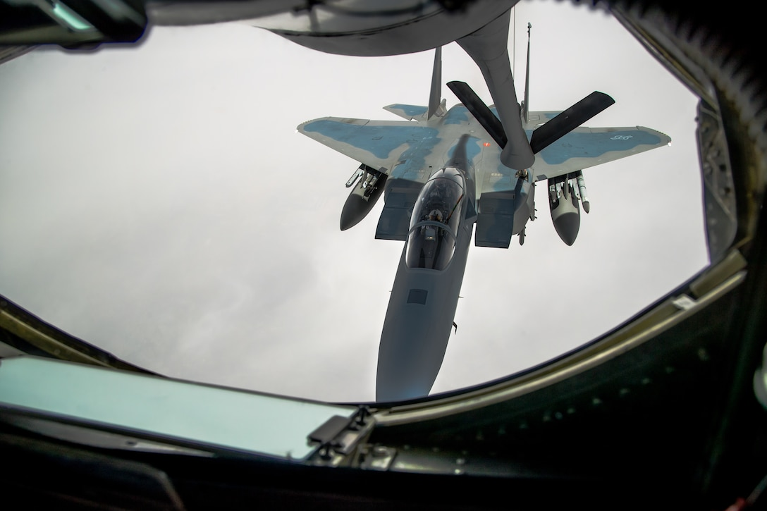 An F-15EX Eagle II from the 40th Flight Test Squadron, 96th Test Wing out of Eglin Air Force Base, Florida, flies in formation during an aerial refueling maneuver with a KC-135 Stratotanker from the 370th Flight Test Squadron out of Edwards Air Force Base, May 14. The Eagle II participated in the Northern Edge 21 exercise in Alaska earlier in May. (Air Force photo by Ethan Wagner)