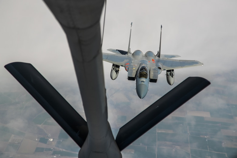 An F-15 from the 85th Test and Evaluation Squadron, 53rd Wing, out of Eglin Air Force Base, Florida, conducts aerial refueling operations with a KC-135 Stratotanker from the 370th Flight Test Squadron out of Edwards Air Force Base, above the skies of Northern California, May 14. The aircraft participated in the Northern Edge 21 exercise in Alaska earlier in May. (Air Force photo by Ethan Wagner)