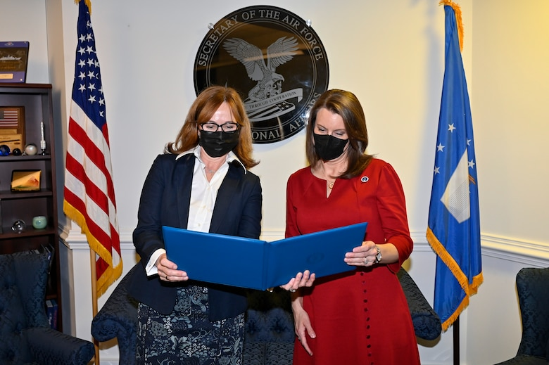 Kelli Seybolt, left, deputy undersecretary of the Air Force for international affairs, presents the Air Force International Affairs Excellence Award to Robyn Disselkoen-Russell during a ceremony at the Pentagon, Arlington, Va., April 29, 2021. Disselkoen-Russell won the 2019 senior civilian category for her work as the deputy chief of international affairs, Directorate of Strategy Plans and Programs, Pacific Air Forces. (U.S. Air Force photo by Eric Dietrich)