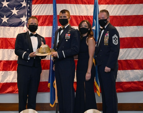 Lt. Gen. Jim Slife, Air Force Special Operations Command commander, and Chief Master Sgt. Cory Olson, AFSOC command chief, pose for a photo with Capt. Nate Peeler and his wife after presenting Peeler with AFSOC's Outstanding Airman of the Year Award for the Company Grade Officer category during a ceremony at Hurlburt Field, Florida May