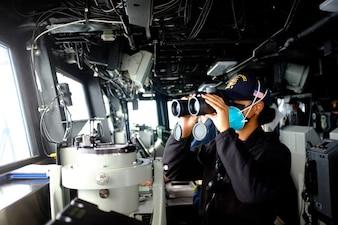 Sailors stand watch aboard USS Tripoli (LHA 7).
