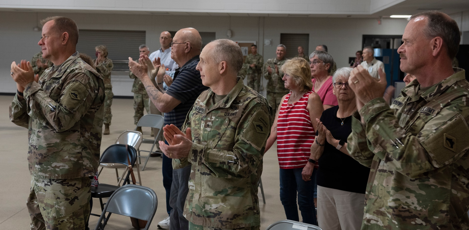 Guests applaud for Soldiers assigned to Task Force Mansfield at the end of the task force's sendoff ceremony May 18, 2021, at Camp Colchester, Vermont. The task force will deploy to the U.S. European Command area of operations for about one year.