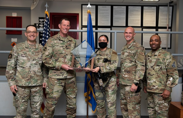 Members of security forces on Peterson Air Force Base posing with the award